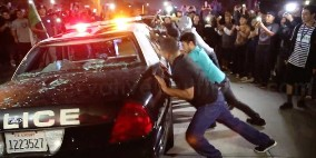 Trump-protestersHundreds-Of-Donald-Trump-Protesters-Surround-And-Destroy-Police-Car-At-Costa-Mesa_-California-Rally
